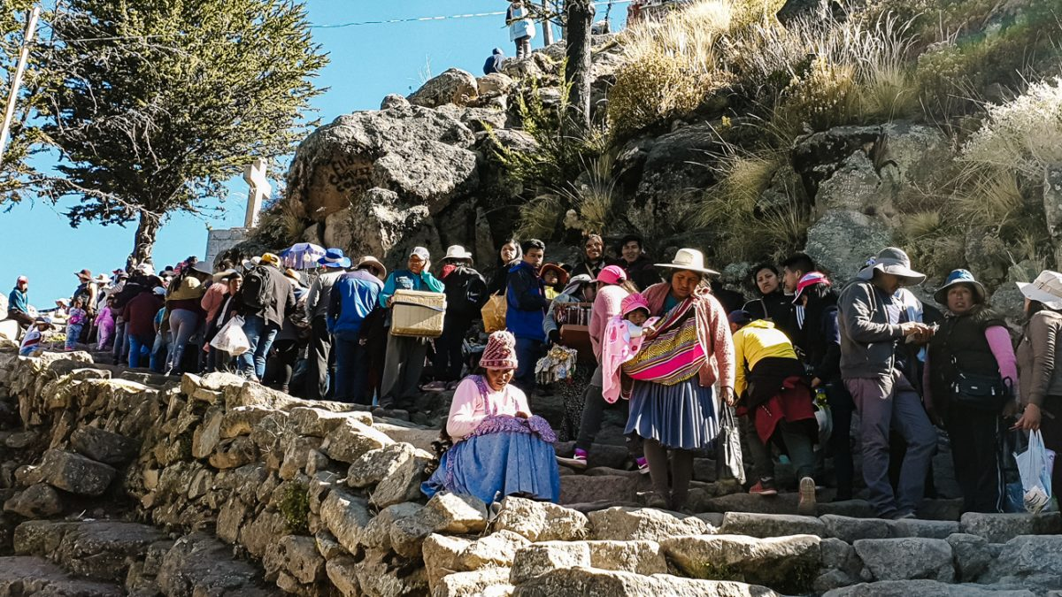 people waiting in line on Cerro Calvario during Independence Day, one of the best things to do in Copacabana Bolivia