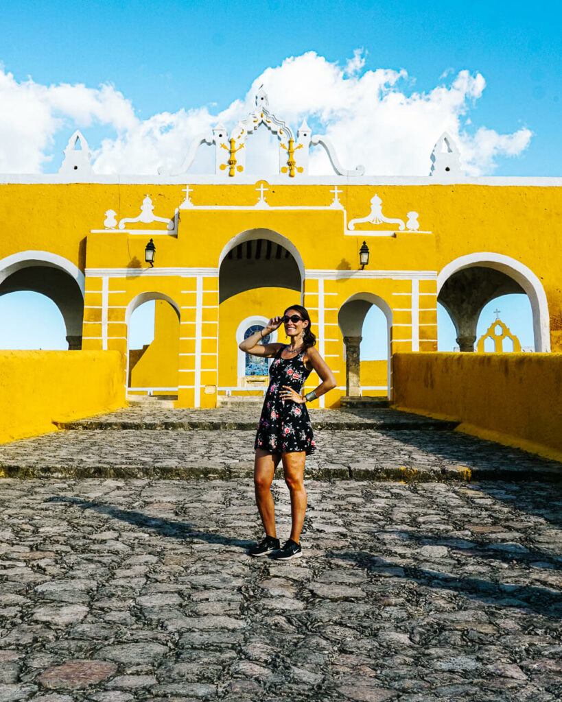 Deborah in front of yellow convent: Convento de San Antonio de Padua, one of the best things to do in the yellow city of Mexico