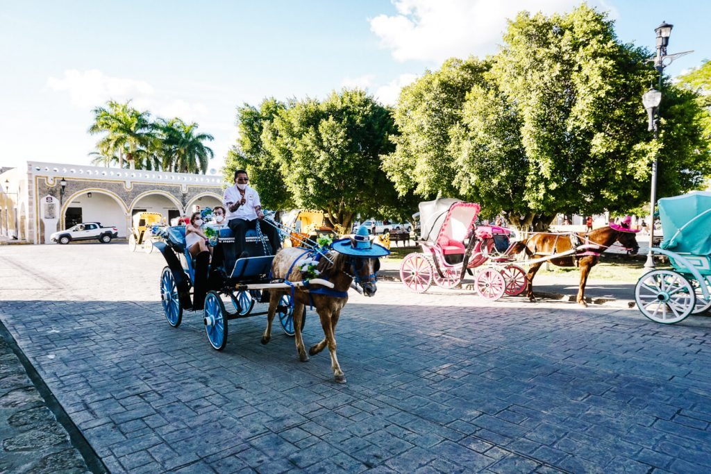 explore the yellow city of Mexico by carriage