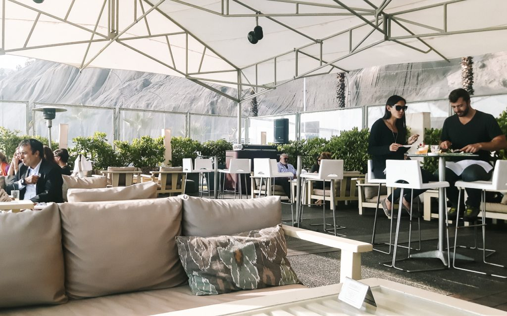 Eat and drink at stylish beach club Cala