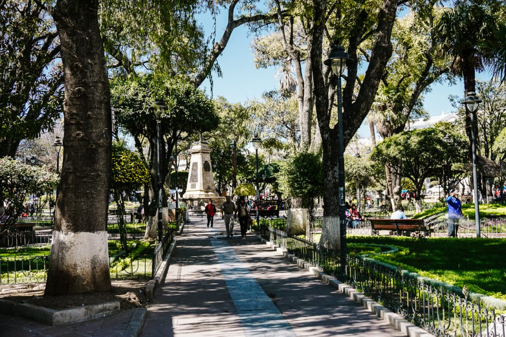 Find a bench and observe local life of Sucre