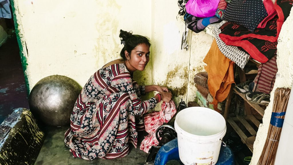 Indian women doing laundry in her home