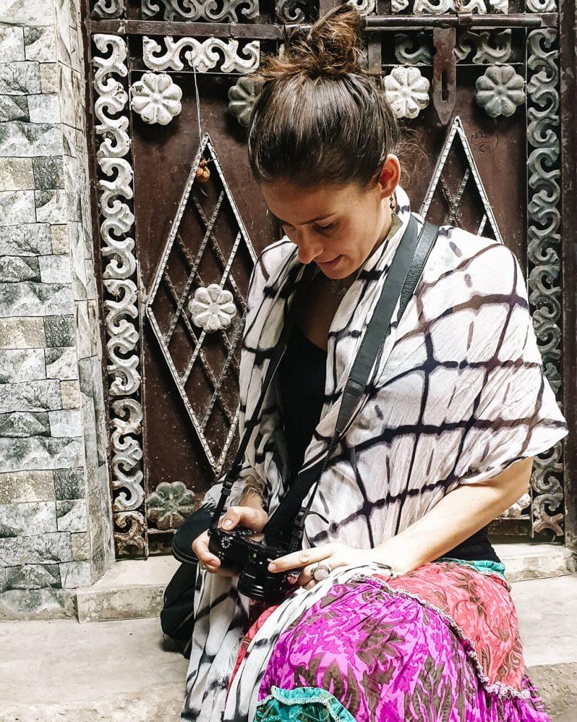 Deborah in Sanjay Colony in India taking pictures