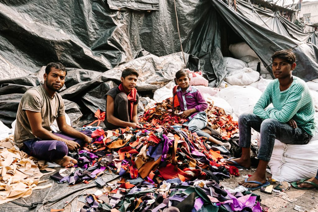 indian men working in recycling of clothes