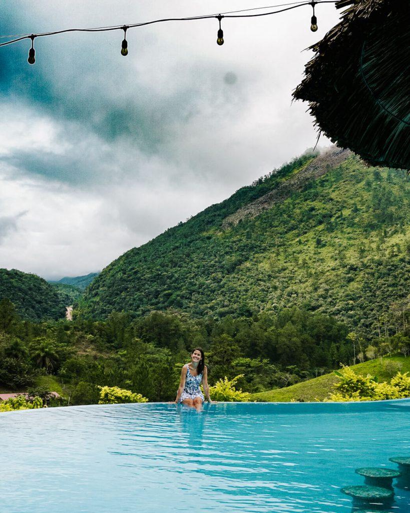 girl in swimmingpool Zephyr lodge in Lanquin