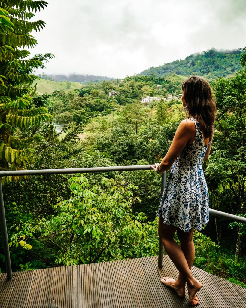 woman at balcony in Zephyr lodge in Lanquin