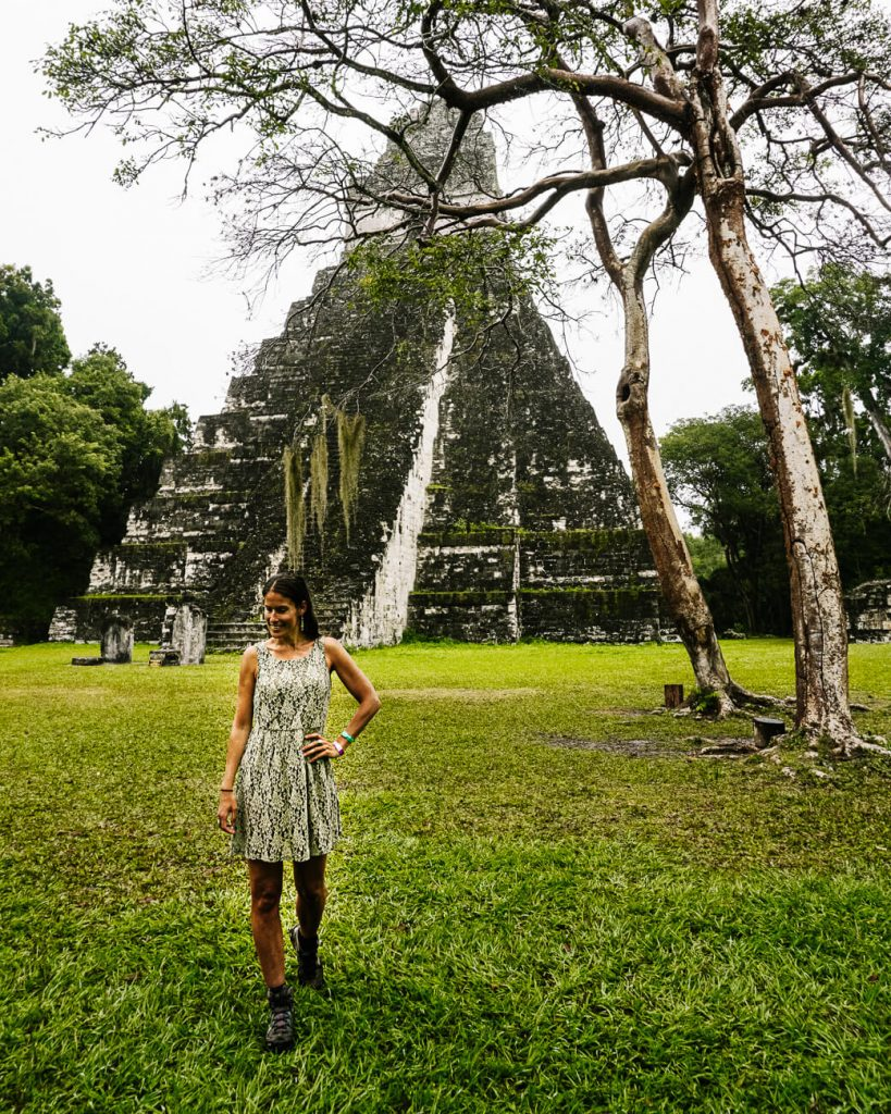 woman in front of pyramid in tikal National Park   a day trip to tikal